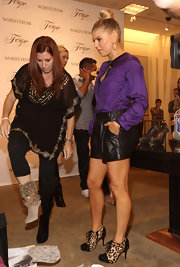 Fergie added pep to her step with animal print lace-up booties complete with black cap-toe detailing.