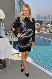 Fergie took snake print to a whole new level in this black silk dress for her press day in NY.
