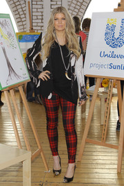 Fergie layered a printed blazer over a black tee for the launch of Unilever's new global program.