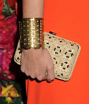 Chiara Clemente chose this straw-print hard case clutch to pair with her tangerine frock for a cool and summery look.