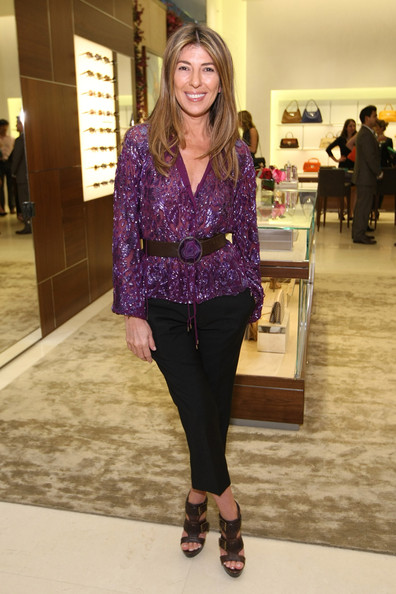 Nina Garcia stepped out to the Ferragamo flagship store opening wearing a pair of chocolate brown leather sandals.