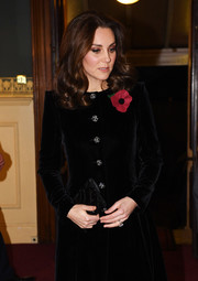 Kate Middleton paired a beaded black clutch with a velvet coat for the Royal Festival of Remembrance.
