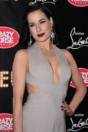 Dita Von Teese attended the premiere of 'Feu' wearing a dark ruby red nail polish.