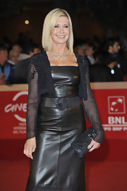 Olivia Newton-John's Rome Film Fest outfit was a combination of textures and accents as she styled her look with a black sequined purse.