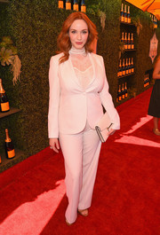 Christina Hendricks wore a striking white tuxedo with a high-necked lace top to the 5th Annual Veuve Clicquot Polo Classic.