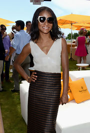 Genevieve Jones wore a satin rectangular pattern V-neck blouse to the VIP Marquee.