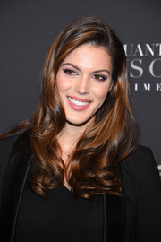 Iris Mittenaere sported a side-parted 'do with curly ends at the Paris premiere of 'Fifty Shades Freed.'