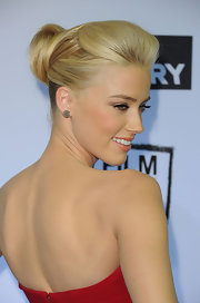 Amber Heard wore her hair in a sleek bobby-pinned updo at a screening of 'The Rum Diary.' Her blond locks were perfectly coiffed.
