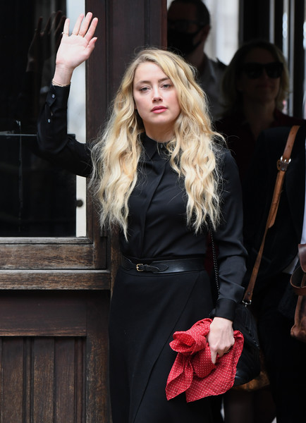 Amber Heard matched a black button-down with a crossover skirt for the final day of Johnny Depp's libel trial.