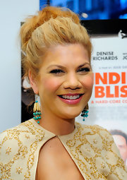 Kristen Johnston paired her embellished ensemble with a textured high bun.