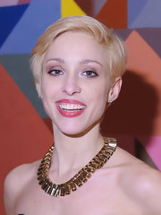 Katherine Helen highlighted her strapless neckline with a gold Sunray Tube and Boxchain necklace.