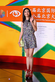 Yao looked sweet in a colorful abstract print romper for the closing of the Beijing International Film Festival.