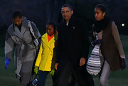 Michelle Obama added a cool pop of color to her get-up with a pair of blue leather gloves.