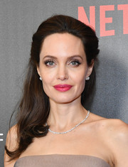 Angelina Jolie looked radiant with her bright pink lipstick and luminous complexion.