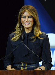 Melania Trump styled her dress with an oversized navy leather belt by Dior for a Las Vegas Town Hall meeting.