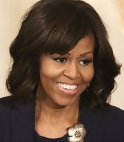 Michelle Obama wore her hair in a lovely wavy style with bangs when she hosted the cast and crew of '42' at the White House.