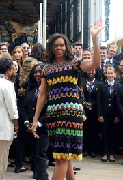 Michelle Obama traveled in Milan, Italy wearing a brightly embellished dress.
