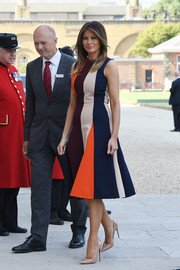 Melania Trump looked fetching in a color-block midi dress by Victoria Beckham while visiting the Chelsea Pensioners in London.