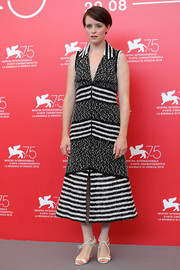 Claire Foy teamed her frock with white ankle-tie sandals.