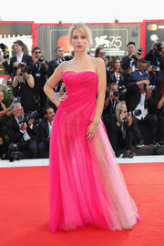 Lottie Moss was sweet and sexy at once in a strapless, semi-sheer fuchsia gown by Ermanno Scervino at the 2018 Venice Film Festival opening ceremony.