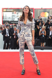Charlotte Le Bon ditched the gown in favor of this printed pantsuit by Christian Dior when she attended the 2018 Venice Film Festival opening ceremony.