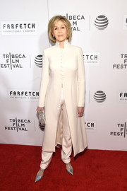 Jane Fonda donned a cream-colored evening coat and matching pants by Valentina Kova for the world premiere of 'The First Monday in May.'
