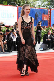 Amanda Seyfried charmed in a black Alexander McQueen gown with an embellished bodice and a patchwork lace skirt at the Venice Film Festival premiere of 'First Reformed.'