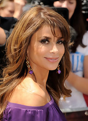 Paula Abdul paired her off-the-shoulder dress with Pan Di Zucchero earrings with purple accents at the ends.