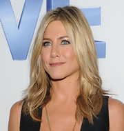 Jennifer Aniston wore her layered locks in casual waves at the 'Five' screening in NYC. To try her look, make a center part and add a few curls to the ends of random sections, then tousle with fingers.
