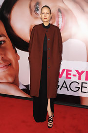 Leelee Sobieski went for a dramatic look in this collarless burgundy coat at the Tribeca Film Festival premiere of 'The Five Year Engagement.'