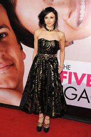 Stacey Bendet was a standout at the premiere of 'The Five Year Engagement' in this strapless gold leaf tea-length dress.