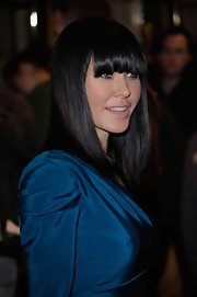 Linzi showed off her jet black blunt cut bangs and shoulder length locks.