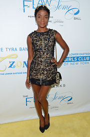 Genevieve Jones wore an intriguing black printed mini dress with multicolored gemstone beads to the Flawsome Ball.