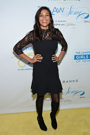 Rosario Dawson let her lacy look steal the spotlight with these simple, sleek black booties.