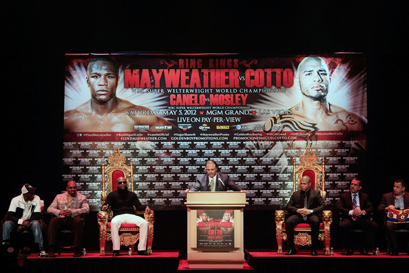 More Pics of Miguel Cotto Men's Suit (1 of 13) - Suits Lookbook - StyleBistro [event,stage,sport venue,floyd mayweather,miguel cotto,r,miguel cotto - press conference,the apollo theater,new york city,las vegas,mgm grand,press conference,fight]