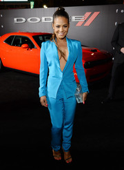 Christina Milian showed off major cleavage at the premiere of 'Focus' in an aqua-blue pantsuit that she wore sans shirt.