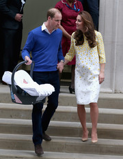 Kate Middleton charmed in a buttercup-print dress by Jenny Packham while leaving St. Mary's Hospital.