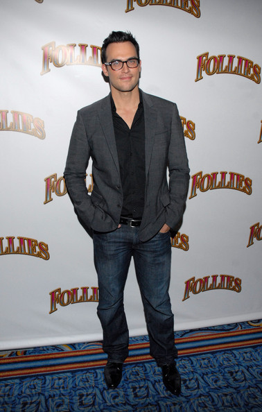 Cheyenne Jackson toned down the formality of his top by pairing it with classic blue jeans.