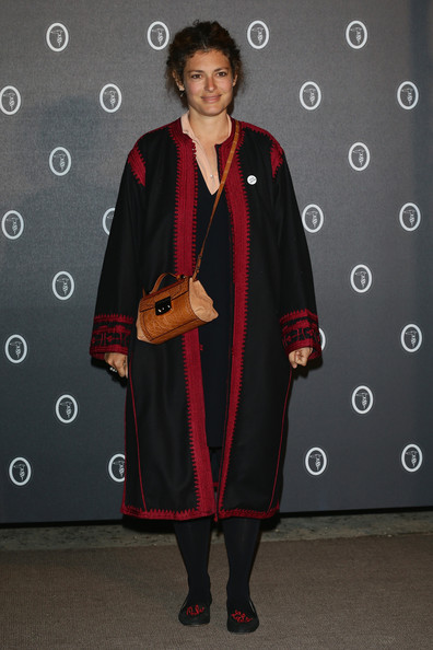 Ginevra Elkann chose a long black evening coat with cranberry red trim for the Fondazione Nicola Trussardi Cocktail Party.