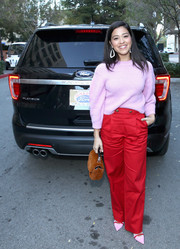 Gina Rodriguez was cozy and cute in a pink crewneck sweater at the Breaking the Glass Ceiling event.