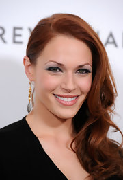Amanda Righetti created her smoky-eyed look using metallic silver shadow and lots of black liner for the 'InStyle' Golden Globe Awards Event.