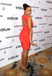 Dania Ramirez showed off her figure at the InStyle Golden Globe event in a tangerine knit dress.