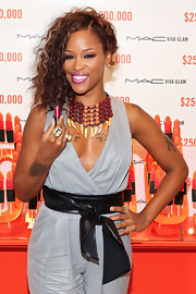 Eve topped off her ensemble with an attention-grabbing animal claw necklace.
