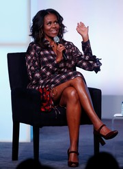 Michelle Obama completed her relaxed look with brown ankle-strap peep-toes.