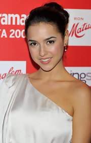 Cristina Brondo looked all-too-chic in her grecian one-shouldered dress and classic bun. She kept her makeup and accessories simple, which let her features shine.