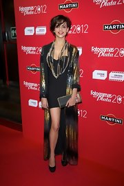 Macarena Gomez paired a sleek mini dress with a long sequined evening coat for a cool and edgy look.