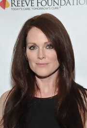 Julianne Moore turned up at the Night For A Cure party with her hair noticeably darker. Her sleek tresses were styled simply with a side part and long layers.