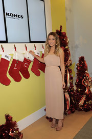 Lauren Conrad rang in the holidays at Kohls in a romantic blush pleated maxi dress with a matching patent belt.