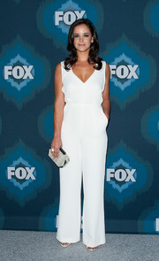 Melissa Fumero complemented her jumpsuit with a geometric-shaped printed clutch.