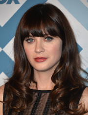 Zooey Deschanel looked youthful with her eye-grazing bangs and curly ends at the Fox All-Star party.